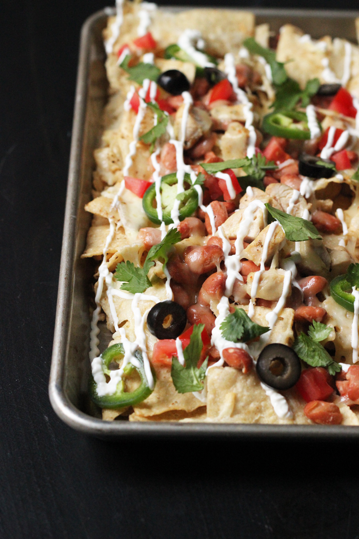 A close up of a tray of chicken nachos