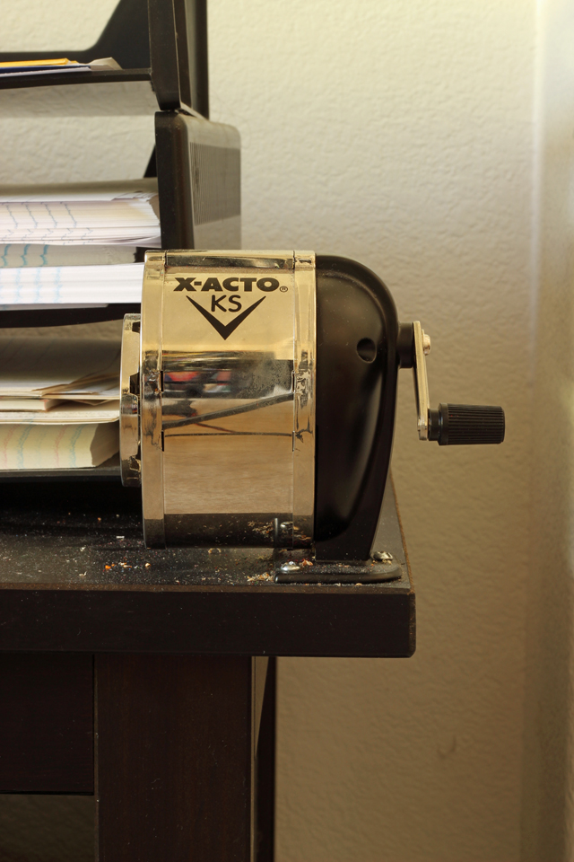 metal pencil sharpener attached to table