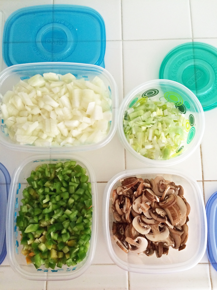 plastic containers filled with different types of food on kitchen counter