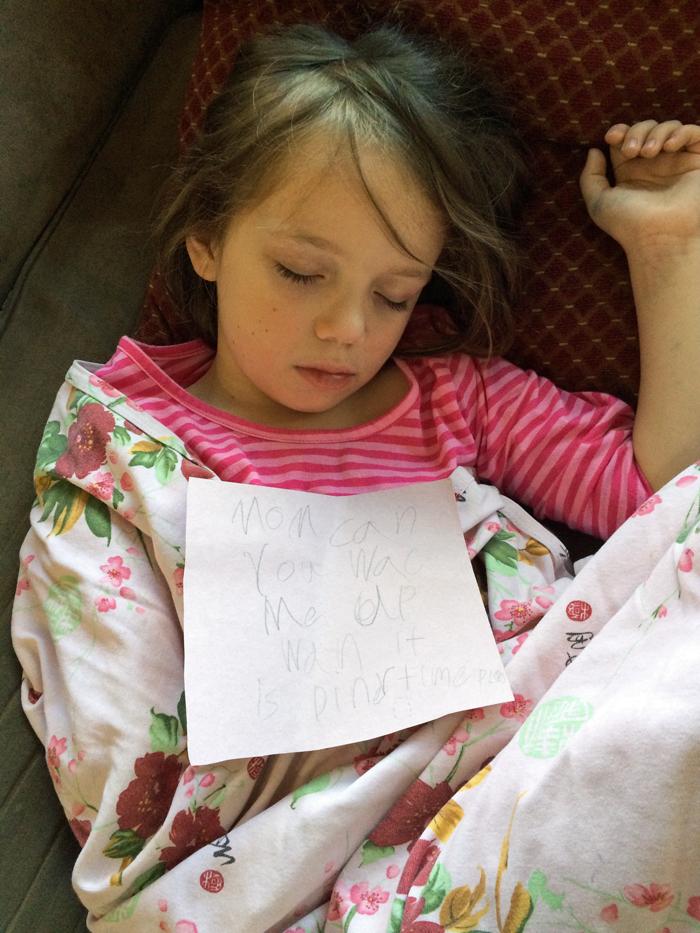 sleeping girl with note