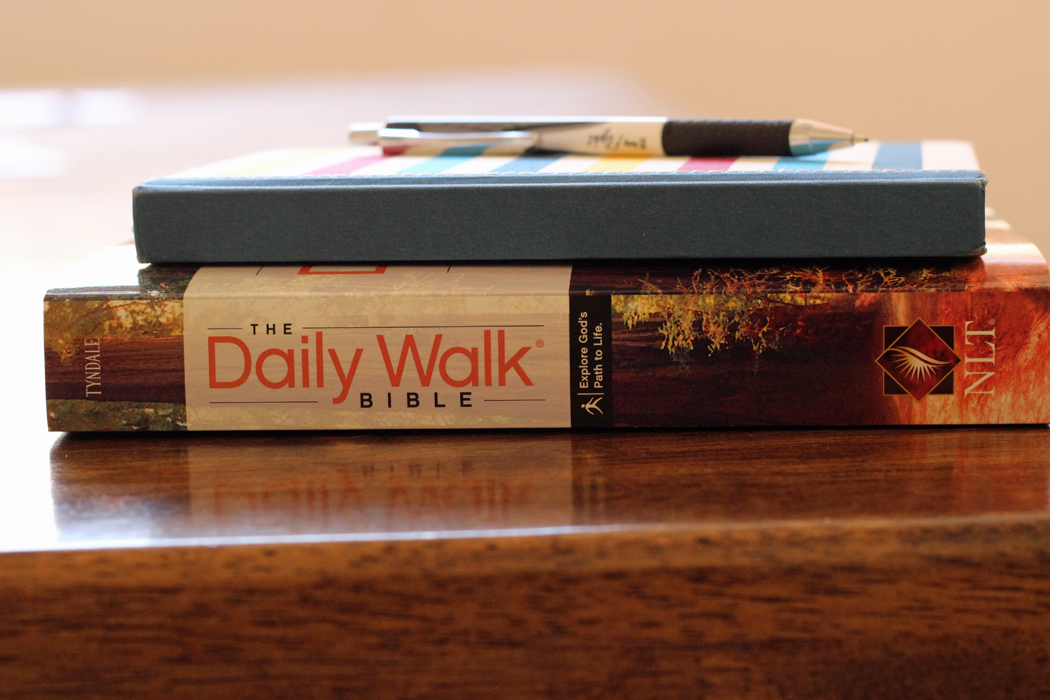 journal and bible stacked on table