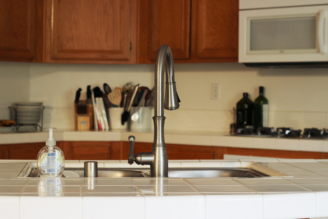 clean kitchen counters with stainless faucet