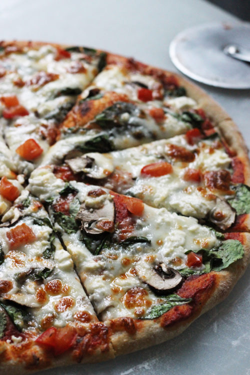 A close up of a Greek pizza