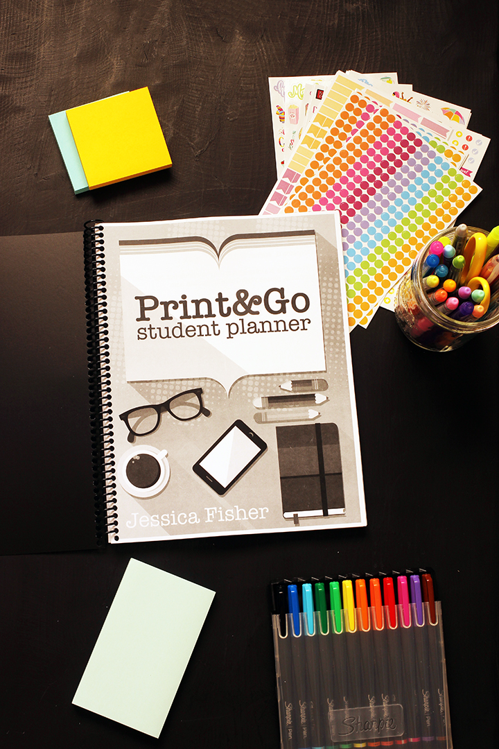 black and white student planner with pens stickers and post-its