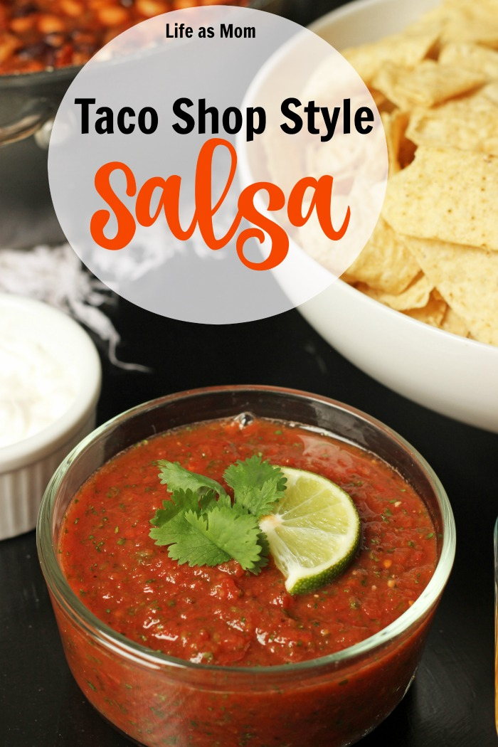 A bowl of salsa next to a bowl of chips