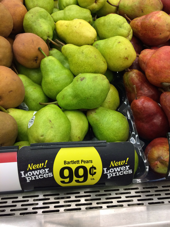 three kinds of pears for sale at the grocery store