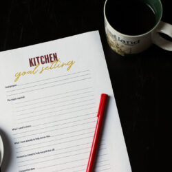 goal setting worksheet with pen on tea table