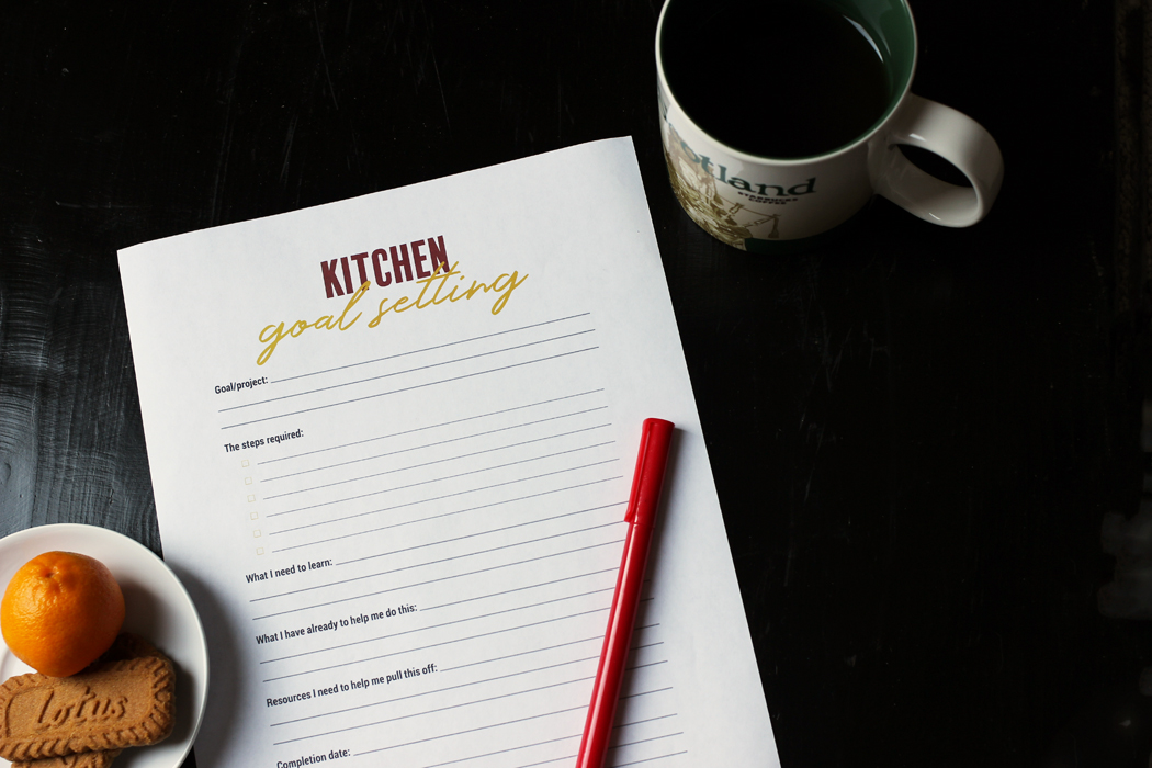goal setting worksheet with pen on tea table