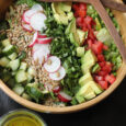 chopped salad layered in wood salad bowl