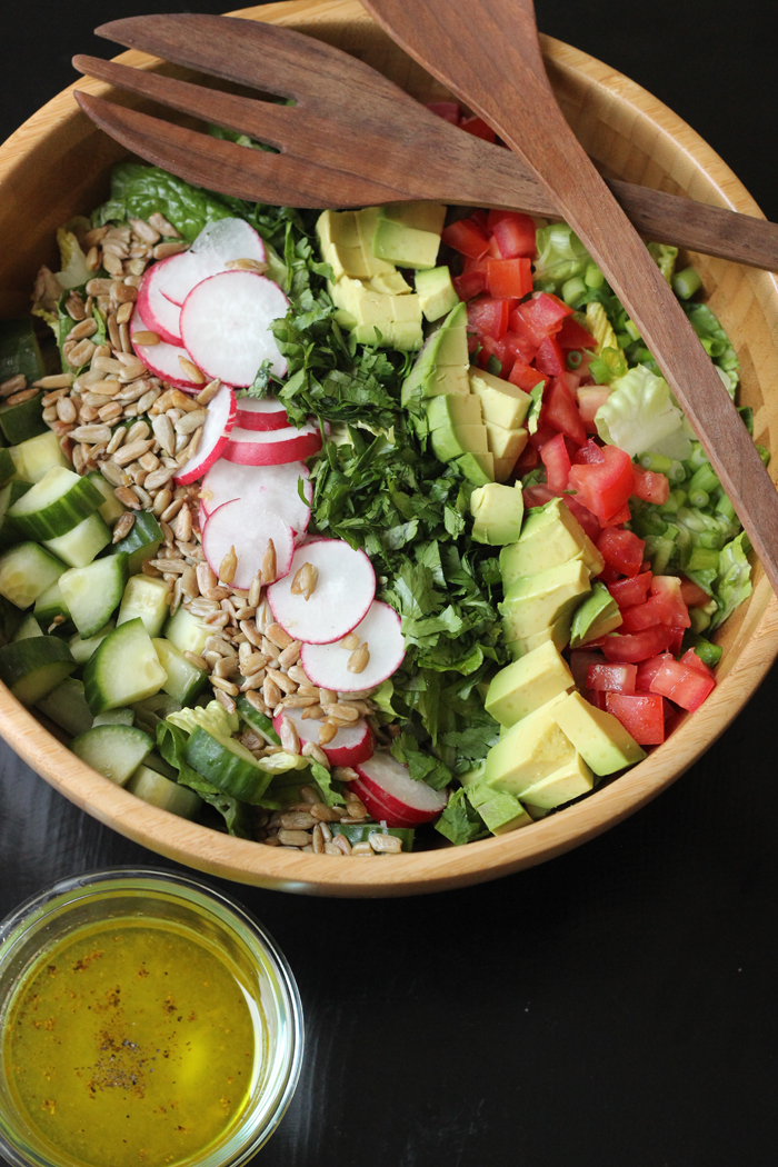 chopped salad layered in wood salad bowl