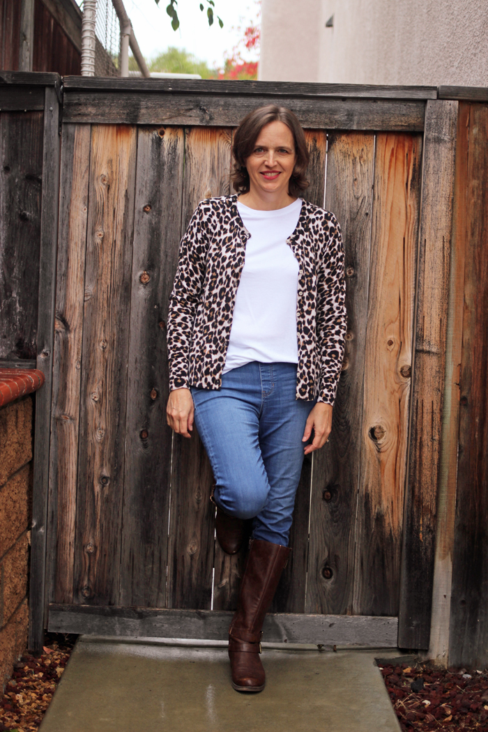 woman in jeans t-shirt and leopard cardigan